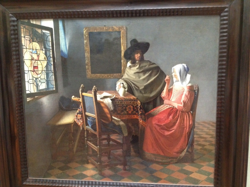 Vermeer at his best. Girl drinking, man pouring, symbolic stained glass window...there's some interesting stuff going on here.