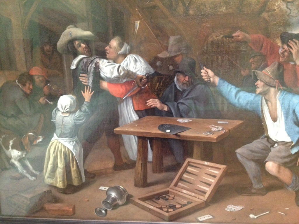 Drunken card players. The guys in the background are priceless.