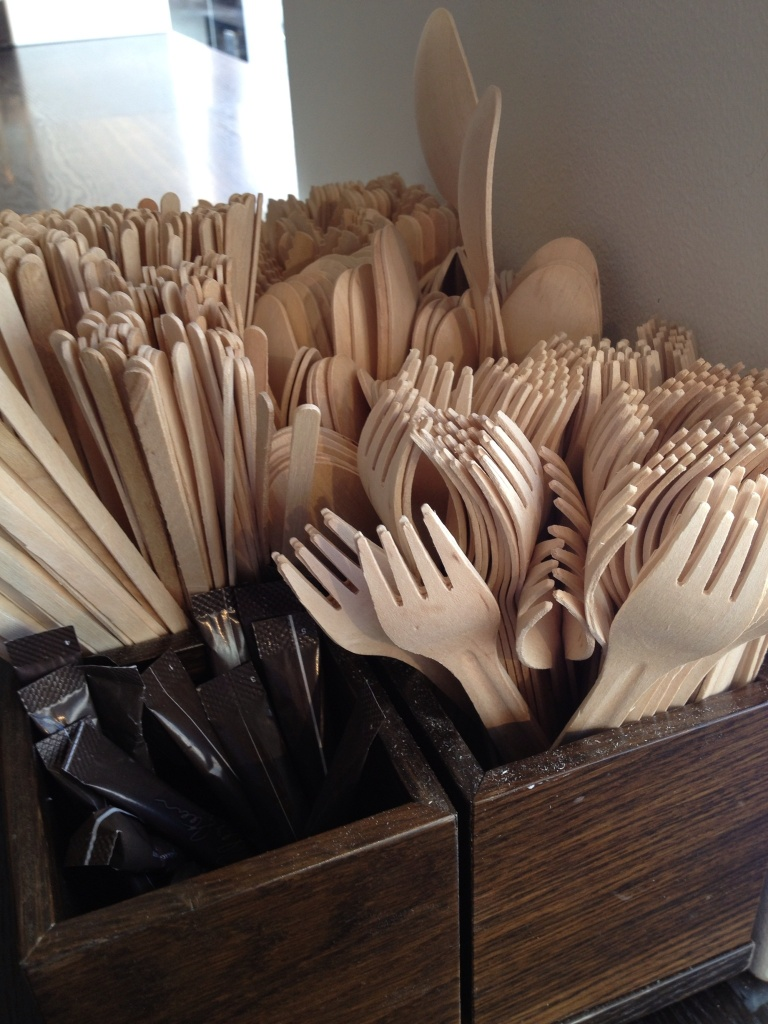 Disposable forks, knives, and spoons made from wood instead of plastic. That's a good idea.