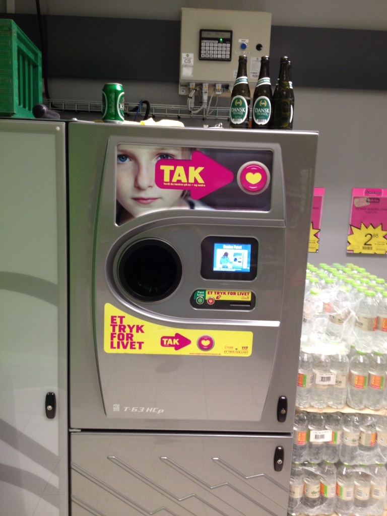 Recycling machine: put your empties in the hole, the machine reads the bar code and prints out a receipt that can be used in the store.