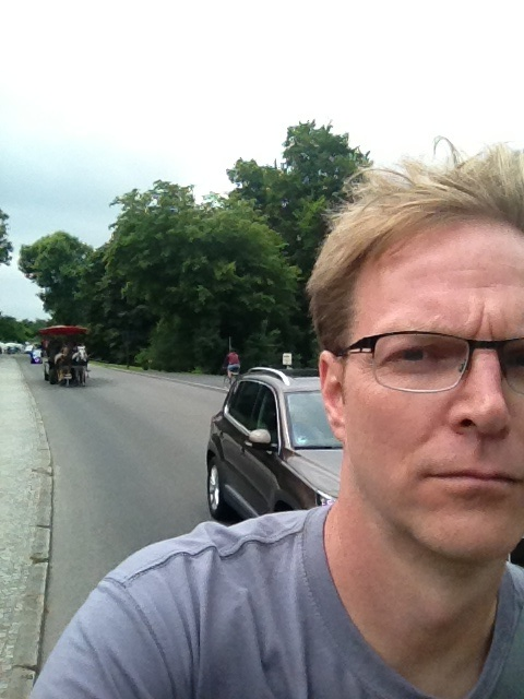 "Doing my job as ""ass man."" Blocking a car, a horse-drawn carriage, and taking an ill-advised picture while riding downhill."