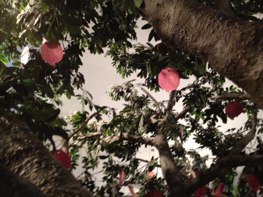 """The Tree of Wishes. Grab a paper apple, write a wish, hang it in the tree. I put, """"I hope the Cubs win the World Series."""" That is a lie, I put up a little hippie note about love and peace."""
