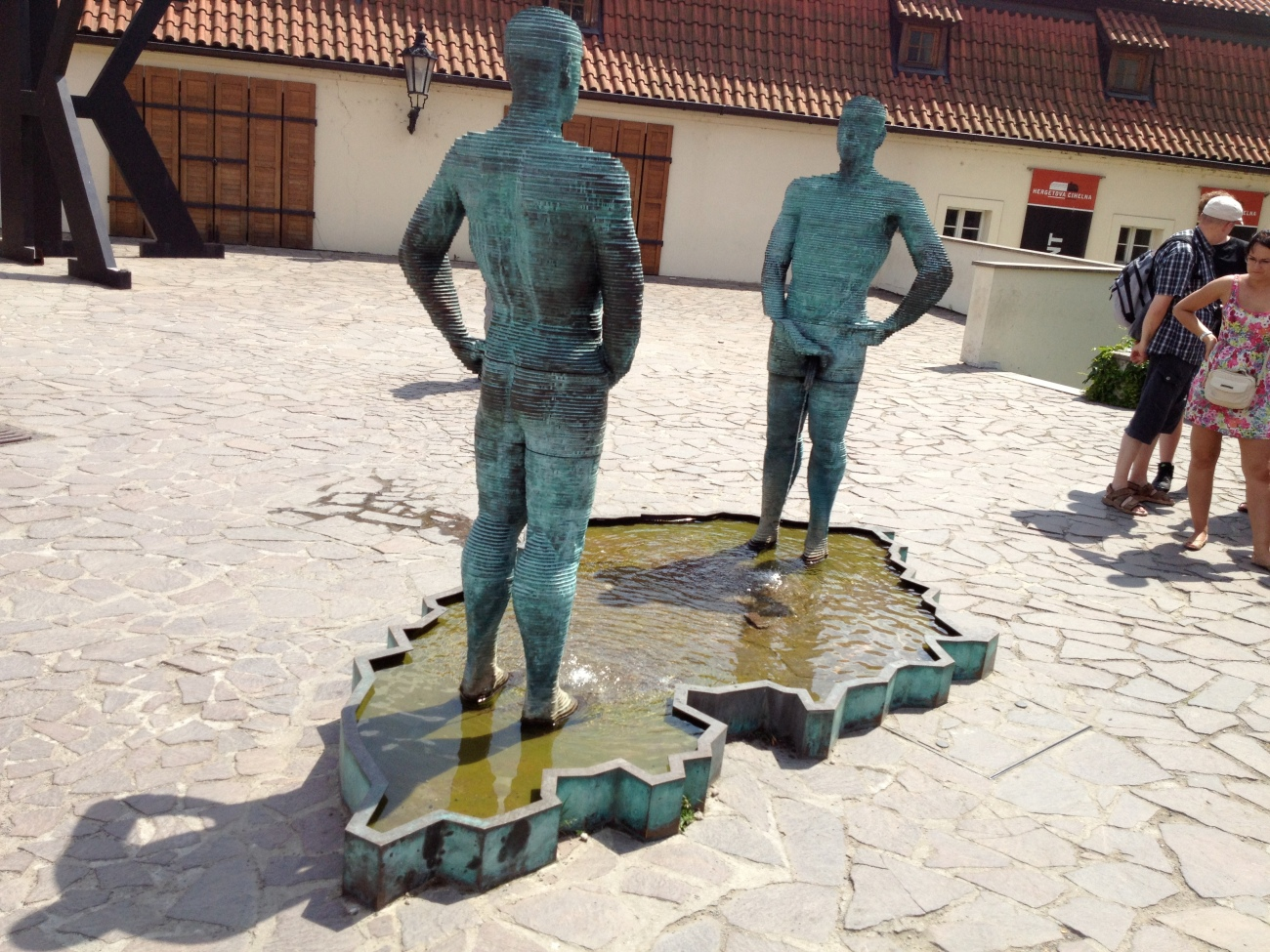 The Pissing Men. That is a map of the Czech Republic they are standing in. Their hips, Anthony Wieners, and hands move to spell out words in the water below.