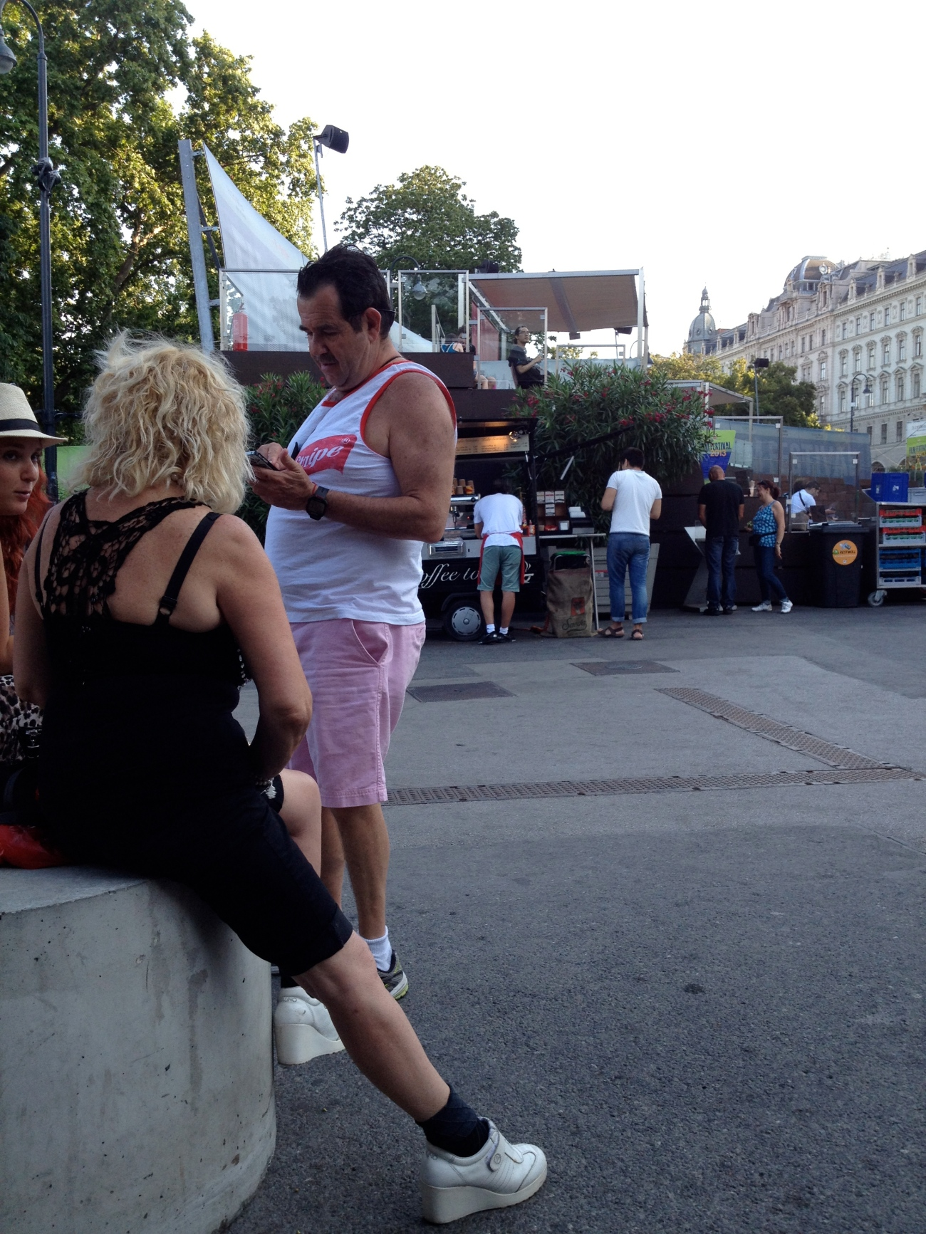 Pink shorts, Red Stripe beer tank top, and Syl Stallone's mom all in one shot.