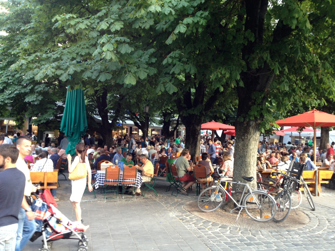 Viktualienmarkt's beer garden under the shady trees.